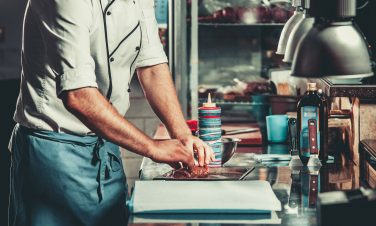 Young chef in kitchen interior